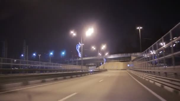The movement of the car over the night auto interchange.