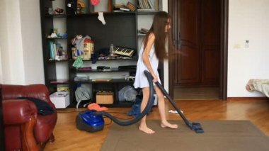 Girl using vacuum cleaner on free videos