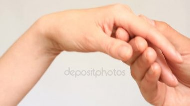 Close-up of a kiss for hands. The man kisses the womans hand. Isolated over white background