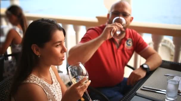 Waiter Serves Banquet Table. Couple in a restaurant. Drinking wine
