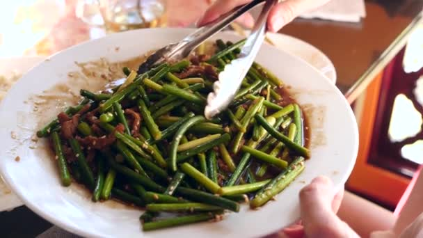People eat chinese food in a chinese restaurant close up slow people eat chinese food in a chinese restaurant close up slow motion forumfinder Choice Image