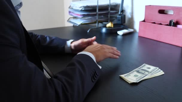 corruption, bribery and fraud concept - close up of businessman taking money. 4k, slow motion