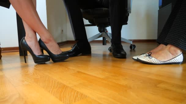 body language. concept of business. feet of business people under the table during negotiations. close-up. 4k, slow-motion