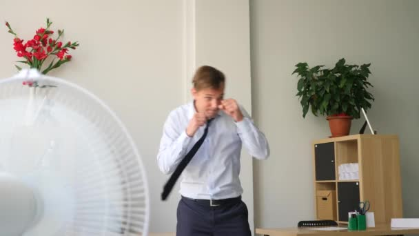 male executive performing workout at her workplace in office. 4k, slow motion