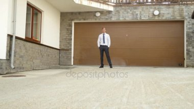 Happy Businessman Is Standing At The Gate Of His House. 4k
