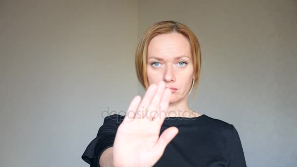4k  Close up of beautiful blonde woman with bright blue eyes  portrait of a  young woman  body language and gestures  disagreement, refusal  she shows  her palm, which means stop