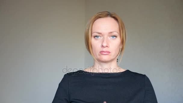 4k. Close up of beautiful blonde woman with bright blue eyes. portrait of a young woman. body language and gestures. disagreement, refusal, she makes a cross with her hands, which means stopping.