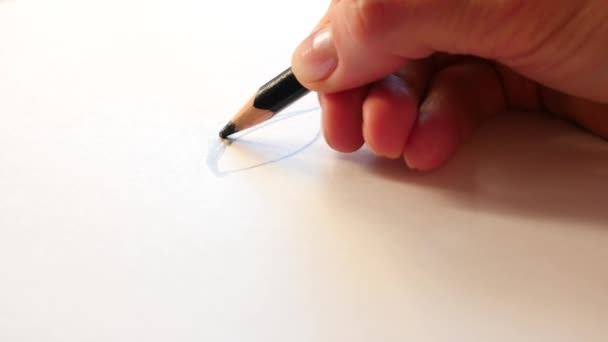 Artists draw a human pencil with a wooden pencil. 4k, slow motion, close-up