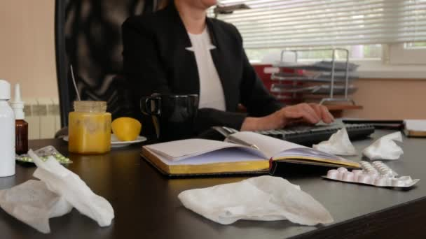 Sick business woman with flu blowing nose in tissue. in the office. 4k