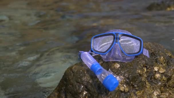 a mask and snorkel on the beach near the sea 4k, slow motion