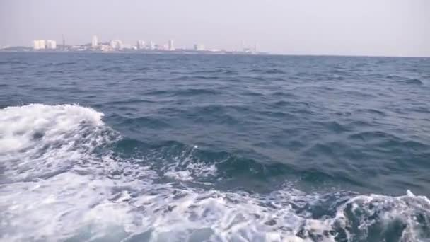 4k, slow-motion, view from the sea to the modern cityscape. skyline