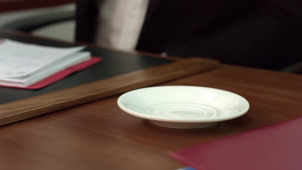 Close-up frame of a coffee mug. Businessman drinks coffee before work.