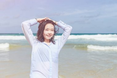 Chinese woman or tourist from asia with happy and relax time on the tropical beach at Karon, Phuket province southern of Thailand