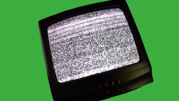 Televíziós közvetítés és csatornaváltás retro TV-n, vintage televízió zöld háttérrel, TV-képernyő be- és kikapcsolása, zajstatikus koncepció