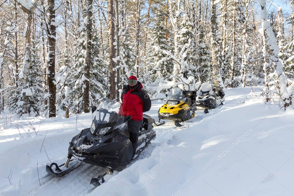 Three snowmobiles and a girl