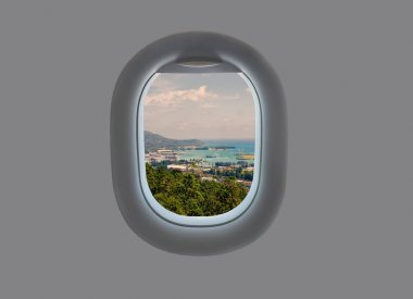 Panorama of the island of Mahe in the plane window. Tropical Seychelles in airplane window