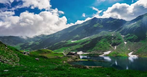 ROMANIA, TRANSFAGARASAN, SIBIU - AUGUST 15 2019 Beautiful lake time lapse video with mountains and amazing clouds.