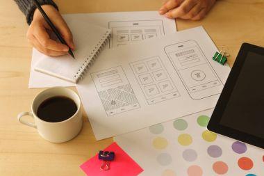 Designer drawing mobile App wireframes