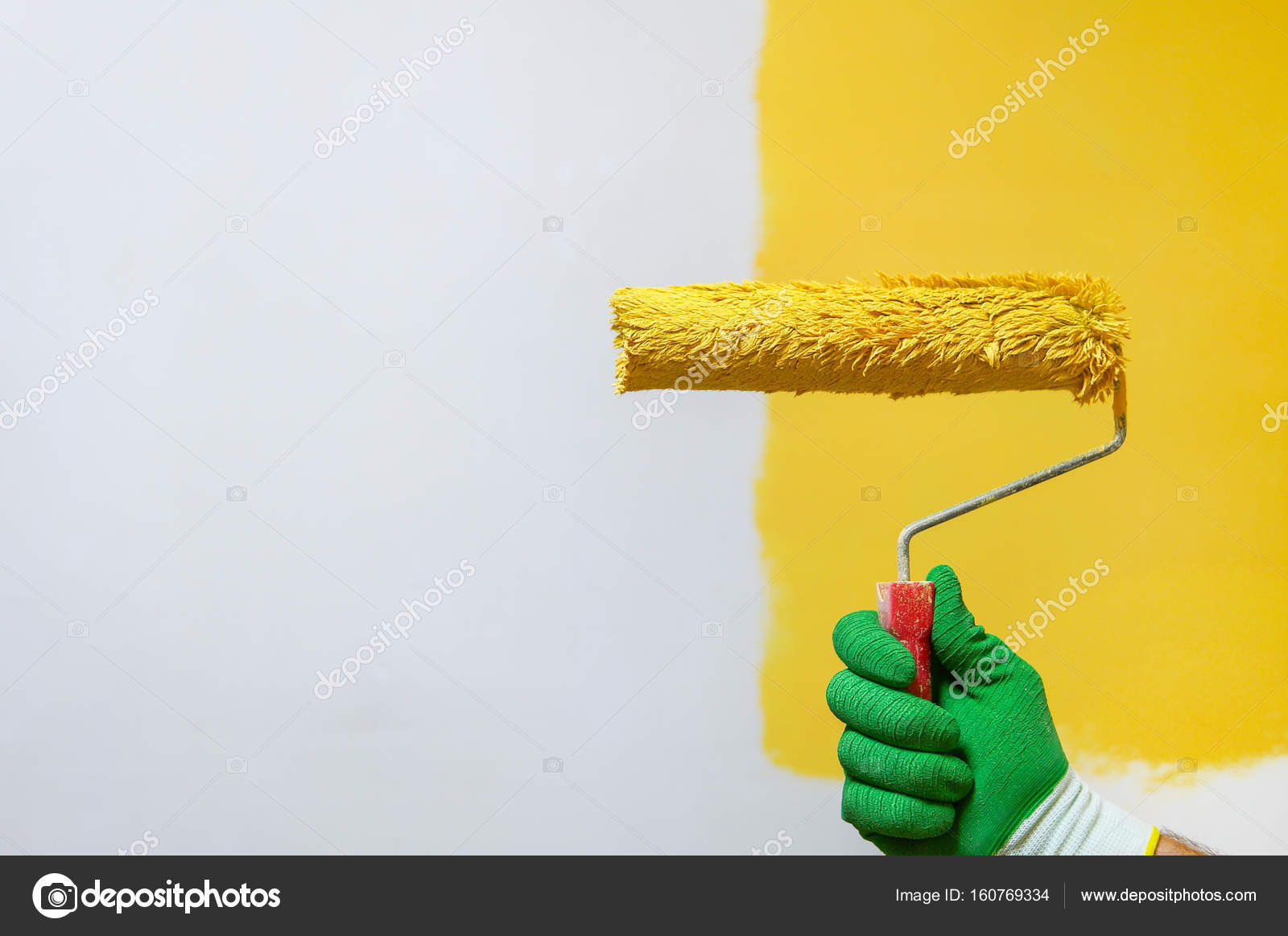 Man holds roller brush with yellow — Stock Photo © PEPPERSMINT ...