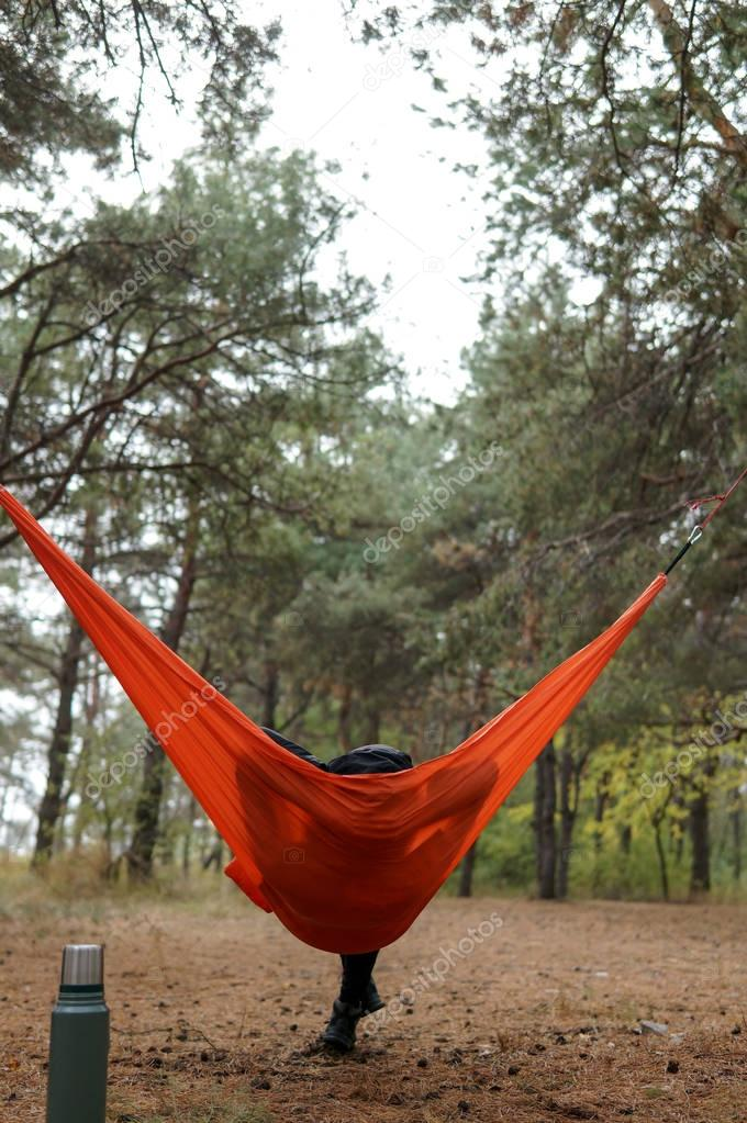 Woman Hiker Relaxing in Hammock in beautiful forest national park