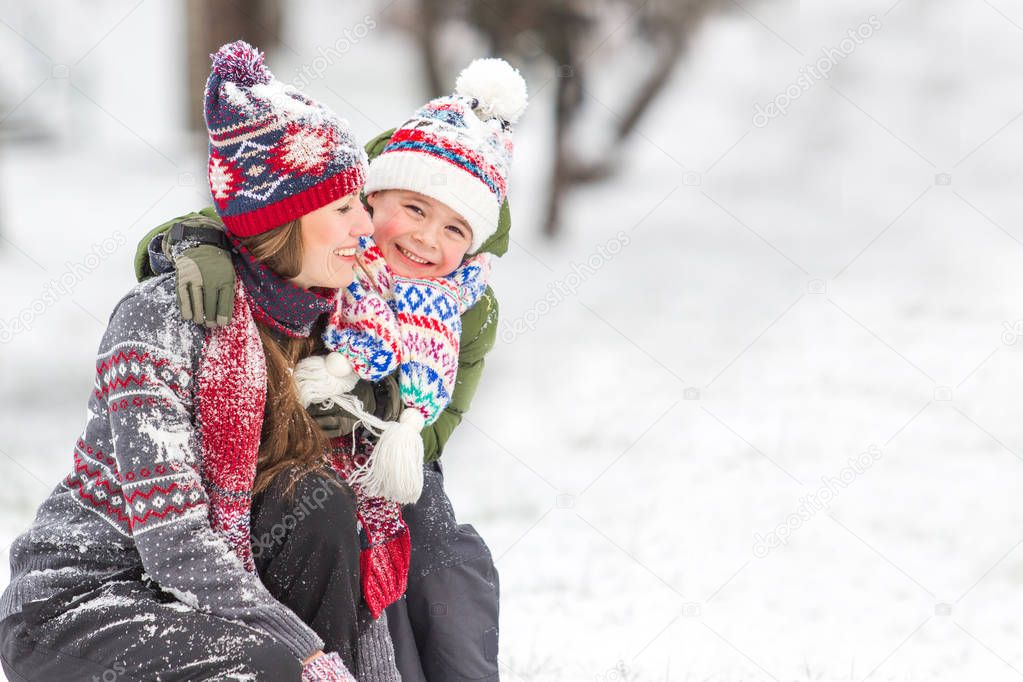 Happy family outdoors playing with snowflakes