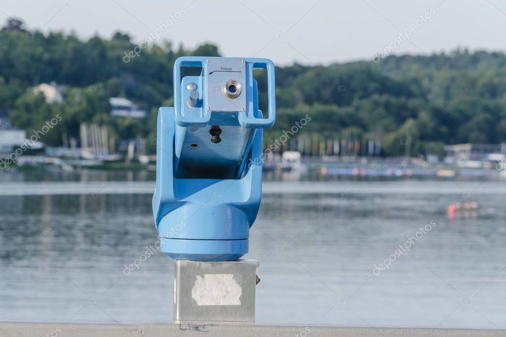 Stationary binoculars overlooking a lake