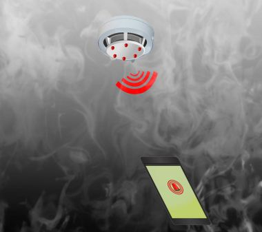 Smoke detector on the ceiling Mobile phone with fire alarm
