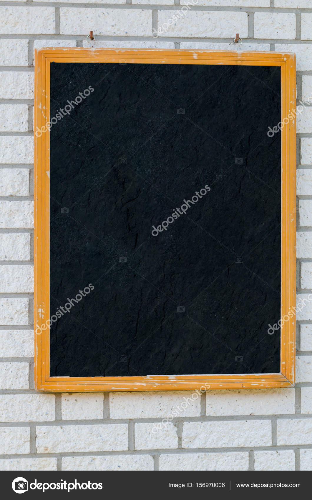 Rustic Menu Board On A Stone Wall Stock Photo
