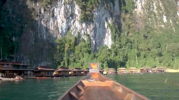 Longtail boat at the lake of Khao Sok Thailand, long tail wooden boat at the lake during sunset Khao Sok Lake