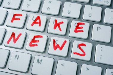 Words fake news written on a keyboard.