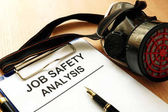 Clipboard with document Job safety analysis.
