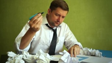 Stressed Manager working with documents. Problems in business.