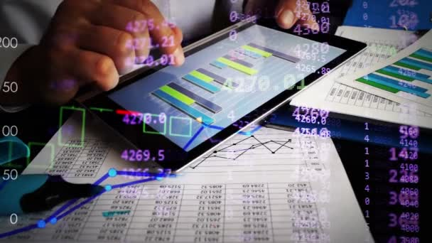 Financial analyst working with business charts and financial figures online on a tablet.