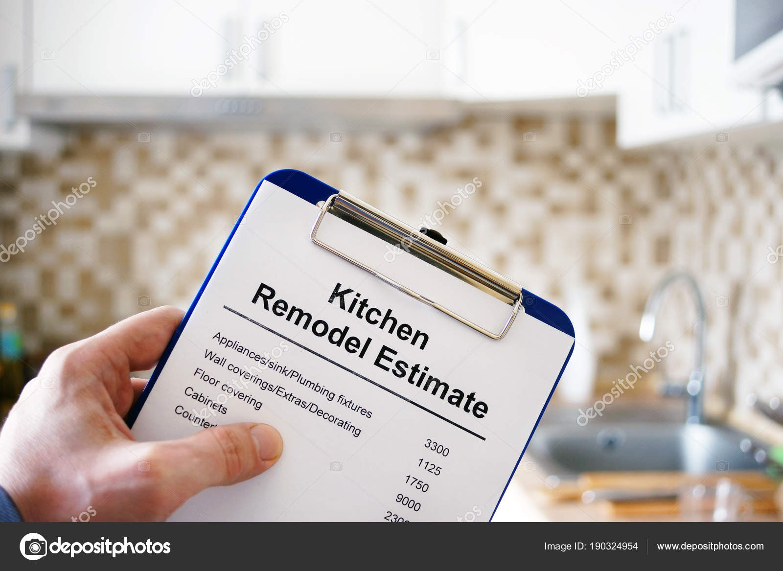 clipboard with kitchen remodel estimate cost of renovation stock