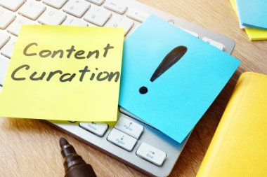 Content Curation. Memo stick on a keyboard.