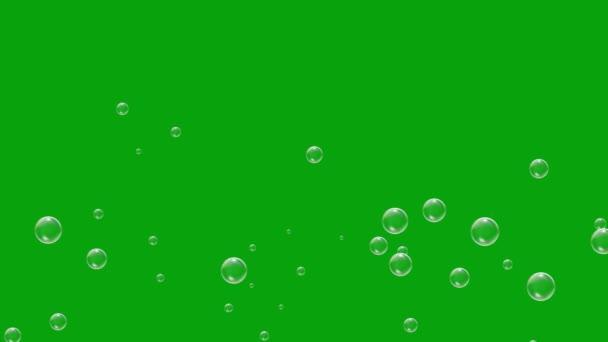 Létající mýdlové bubliny se zeleným pozadí obrazovky