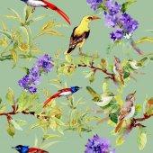 Fotografia Modello senza cuciture con gli uccelli sui fiori violetto