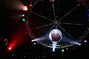 The disco ball with light rays in night club. Party background.