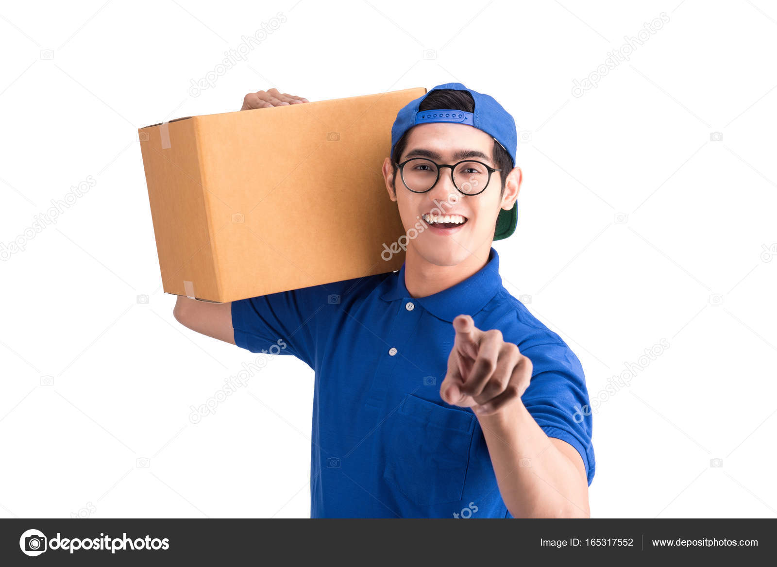 cheerful delivery man happy young courier holding a box stock