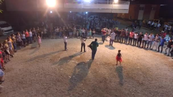 This is a real ethnic village wedding. Dances of the Romani gypsies people. Halay dancers form a circle or line. Even hand to hand. Traditional Turkish gypsy henna night. Middle East Anatolia Turkey Balkans Caucasian Kurds Iran Iraq Azerbaijan aerial