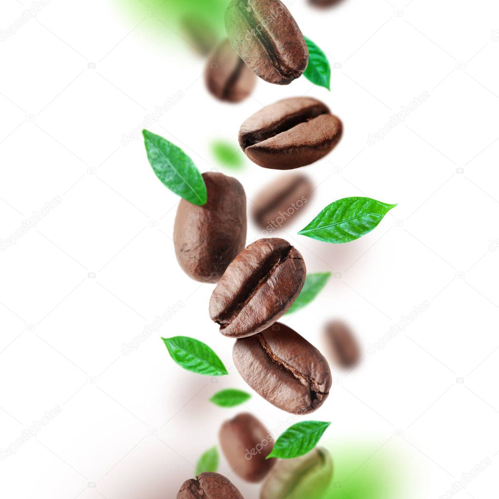 Coffee beans and leaves falling from the air