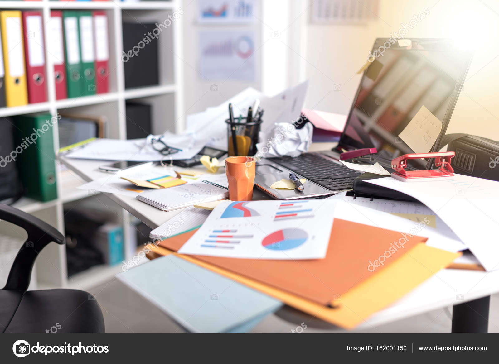 messy and cluttered desk light effect stock photo thodonal