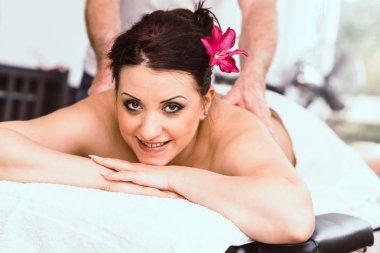Beautiful young woman getting massage