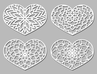 Set of Vector Stencil lacy hearts with carved openwork pattern.
