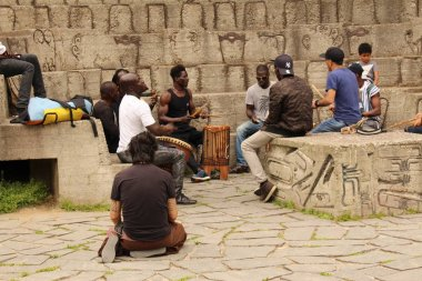 MILAN, ITALY - APRIL 15, 2017: African street musicians are playing percussion instruments (djembe) at Simplon Park (Parco Sempione).