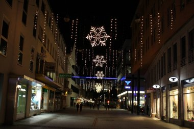 BREGENZ, AUSTRIA - NOVEMBER 23, 2015: A view from Bahnhofstrasse street full of Christmas lights and ornaments in the city center.