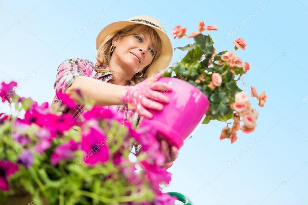 Portrait of mature woman gardening at home