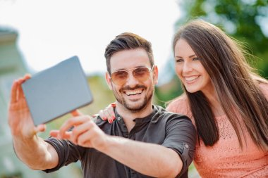 Cropped shot of an affectionate young couple taking a selfie