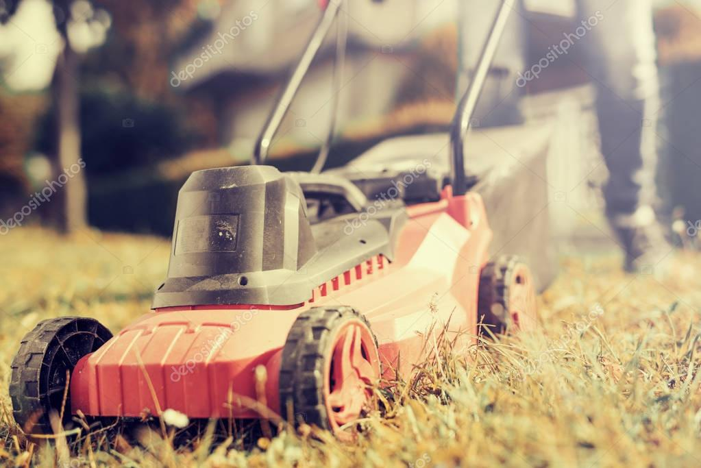 Lawn mower,man cutting grass