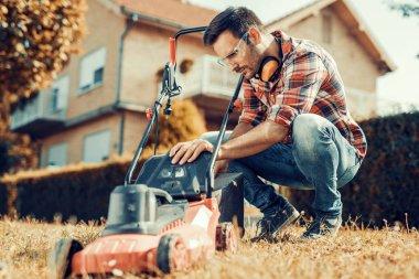 Gardening,man cutting grass